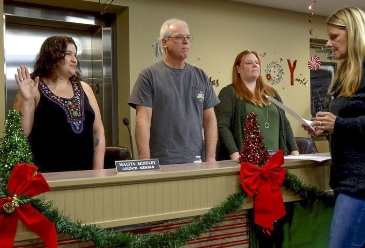 Newly elected Yacolt town council members Malita Moseley, Herbert Noble and Amy Boget are sworn in by Yacolt town clerk Cindy Marbut before the regular town council meeting on Monday night. Photo courtesy of David Ridenour