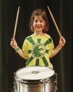 Hough third grade student Natalie Strickland is one of 28 students who are members of the Hough Youth Escola de Samba group. Photo courtesy of Brooke Strickland