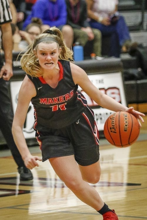 Haley Hanson (11) shows a determined look on her way down the court. Hanson had nine points in Camas' win over Union. Photo by Mike Schultz