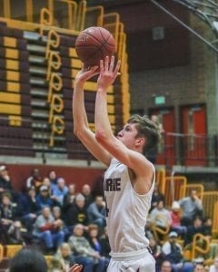 Prairie senior Braiden Broadbent, shown here in a game last season, was a second team all-league performer as a junior for the Falcons. This season, he has helped Prairie win six of its last seven games, including a victory over Kamiakin in which Broadbent made the key bucket. Photo by Mike Schultz