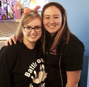 Takara Suhama (right) and Battle Ground teammate Darian Dyer shared quite a moment Friday at the Class 4A district bowling championships. They both tied with a 519 series. Suhama was declared the district champion via tiebreaker. Both will be going to state next week. Photo by Paul Valencia