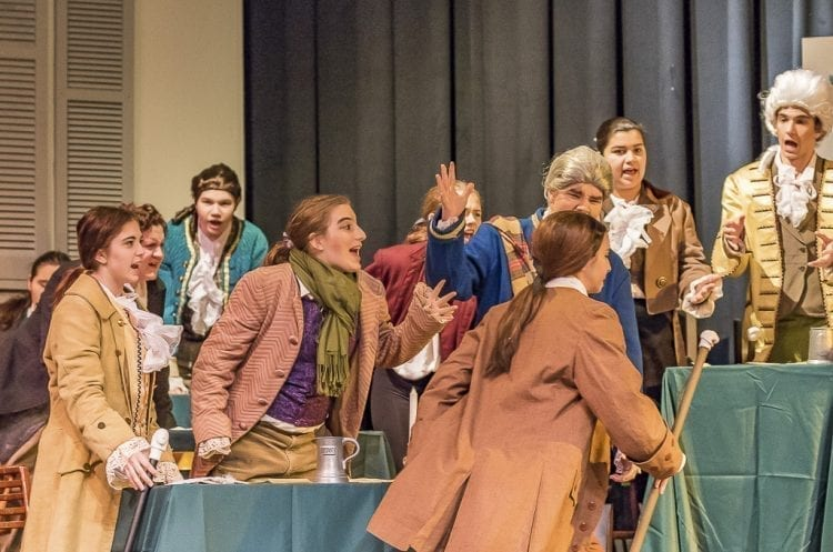 """Members of the Second Continental Congress tell John Adams to sit down during a scene of Heritage High School's """"1776."""" The show is open to the public beginning tonight with more performances Saturday and again next week. Photo by Mike Schultz"""