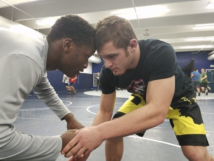 Jackson McKinney (right) said he feels at home on any wrestling mat. Here he is training with Skyview teammate Tiajaie Allen. Skyview is hosting the Clark County Wrestling Tournament this week. Photo by Paul Valencia