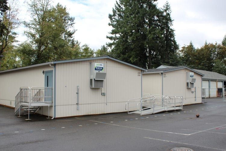 The proposed La Center School District bond, which will pay for a new middle school, is intended to help reduce crowding and compensate for population growth in the district. Portable classrooms have been used in the past, but the district is running out of spaces to put them, and looking at using sports practice fields to house more portables as they become needed. Photo by Alex Peru