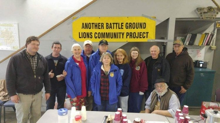 """The Battle Ground Lions club is active in many local community events and programs, and the """"Crabaganza"""" crab feed will help raise funds to support those programs. One of the programs the Battle Ground Lions have been heavily involved with is the annual Clark County Walk and Knock. From left, Patrick Steinke, Perry Gastineau, Bev Jones, Ken Steinke, Al Kostman, Jeanne Kostman, Pam Comstock, Ursula Ansell, Tom Schultz, Glen Comstock, and Louie Vander Wal (seated) all helped participate in the 2017 Walk and Knock. Photo courtesy of Battle Ground Lions Club"""