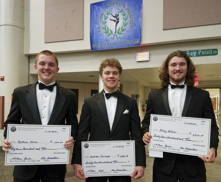 "The winners from the ""backs"" category of the 26th annual Scholar-Athlete Awards Banquet for the Clark County chapter of the National Football Foundation and College Hall of Fame: From left to right, Nathan Kunz of Columbia River, Mitchell Delmage of Mountain View, and Riley Miller of Union. Photo by Paul Valencia"