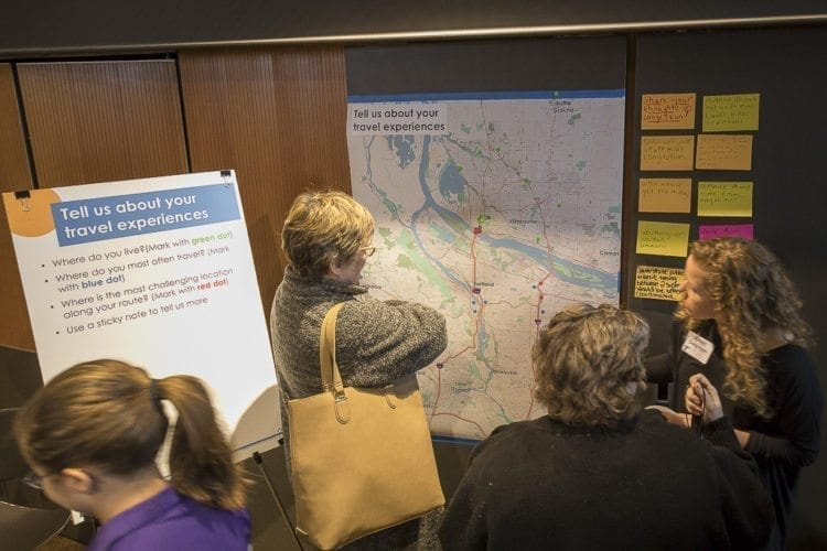 Clark County residents gathered at the Vancouver Public Library Tuesday to learn about Oregon's proposal to add tolls to the interstates in Portland and provide feedback to ODOT representatives during an open house. Photo by Mike Schultz