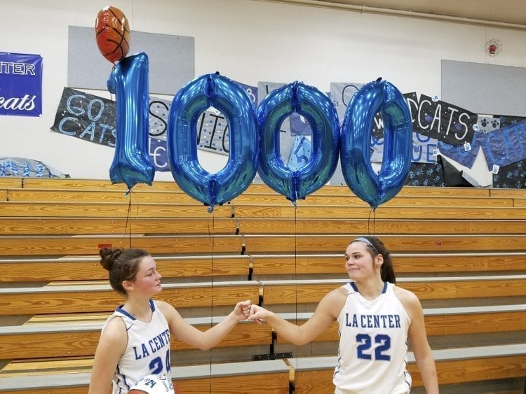 La Center junior Taylor Stephens (left) got to 1,000 points in her career Thursday night. The home crowd celebrated with a short ceremony. The home crowd did the same last month for Taylor Mills, when she hit the same milestone. The two Taylors have more than 2,000 points between them for the Wildcats. Photo by Paul Valencia