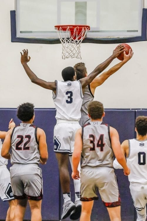 Skyview's Samaad Hector (3) blocks a shot attempt during a 59-55 Storm victory over Union Friday at Skyview High School. Photo by Mike Schultz