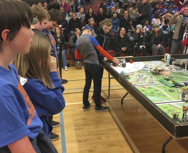 View Ridge Middle School students Cayden Lauder (left) and Kaison Apol prepare their robot at a FIRST LEGO League competition in Olympia in December as their teammates (far left) look on. Photo courtesy of Ridgefield School District