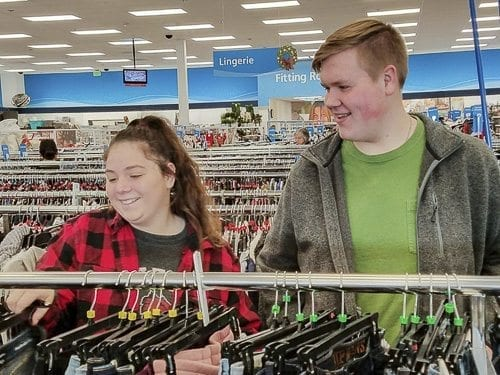 Katelyn Beucsher, president of Woodland High School's Interact Club, and Cooper Kaml, vice president, hunted through racks of clothes for the right price on the right clothes. Photo courtesy of Woodland Public Schools