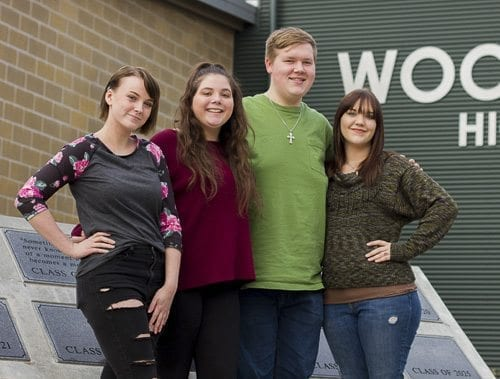 Woodland High School students Samara Wagner-Lindner, Katelyn Beucsher, Cooper Kaml, and Lena Edwards encourage their classmates to volunteer and discover how small acts of kindness can make a huge difference to their community. Photo courtesy of Woodland Public Schools