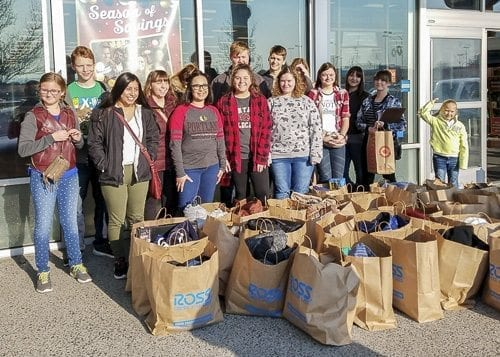 Woodland High School's Interact Club organized 14 student volunteers to buy food, clothes, and gifts for more than 100 needy families in December. Photo courtesy of Woodland Public Schools