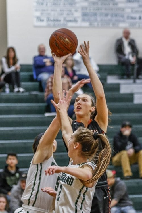 Washougal's Beyonce Bea splits a double-team on the way to the basket Tuesday night, helping the Panthers to another Class 2A Greater St. Helens League girls basketball victory. Bea had 26 points, 18 rebounds, and six blocked shots in a 59-29 win at Woodland. Photo by Mike Schultz