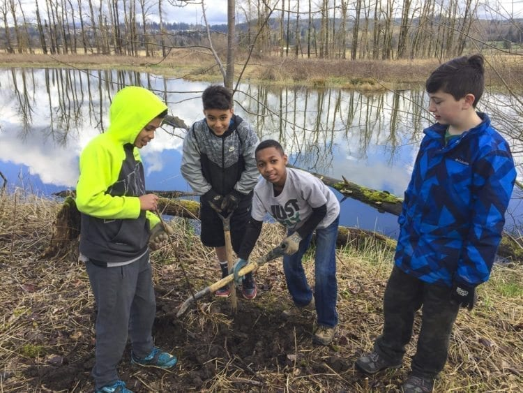 Students from Dorothy Fox Elementary in Camas are shown here planting trees in the Steigerwald National Wildlife Refuge. A grant front the Camas-Washougal Community Chest helps the Lower Columbia Estuary Partnership provide classroom lessons and outdoor applied learning programs for youth, including habitat enhancement projects adjacent to Gibbons Creek in the Steigerwald Lake National Wildlife Refuge. Photo courtesy of the Camas-Washougal Community Chest