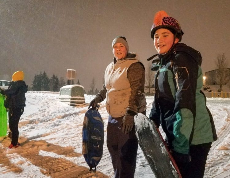 Fiona Belden (right) and her mother Tricia Belden found the hill near McKenzie Stadium in east Vancouver to be a fun place to spend the wintry evening Wednesday. Photo by Paul Valencia