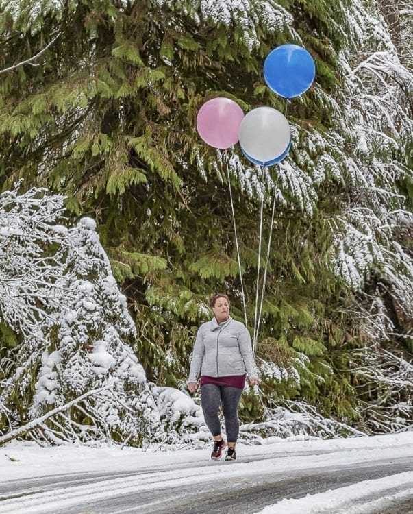 Vancouver resident Katlyn Dato enjoyed the winter weather at a (baby) gender-reveal gathering at Lewisville Park in Battle Ground Wednesday afternoon. Photo by Mike Schultz