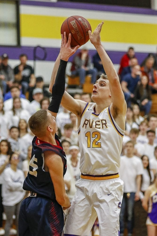 Jacob Hjort, shown here earlier this season, made five 3-pointers in Columbia River's win over Fife on Wednesday at the Class 2A state basketball tournament. Photo by Mike Schultz