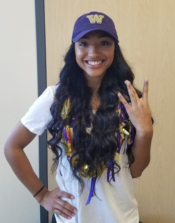 Union soccer standout MaKayla Woods gives the W sign after she signed with the University of Washington. Photo by Paul Valencia