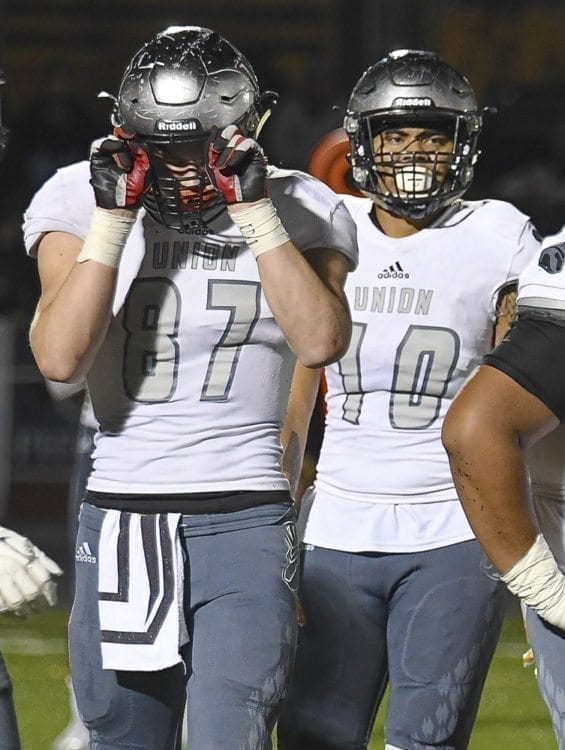 Aiden Nellor (87) and Zion Fa'aopega, teammates from Union, will continue to be teammates in college. Both signed with Eastern Washington University. Photo courtesy of Kris Cavin