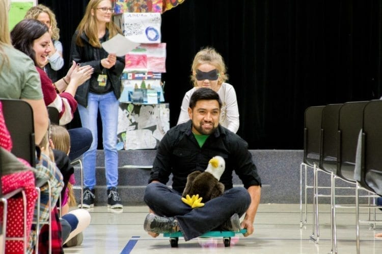The assemblies at Woodland Intermediate School feature team competitions like January's with a race where a blindfolded student had to push a teacher across the gym guided by only the teacher's vocal directions. Photo courtesy of Woodland School District