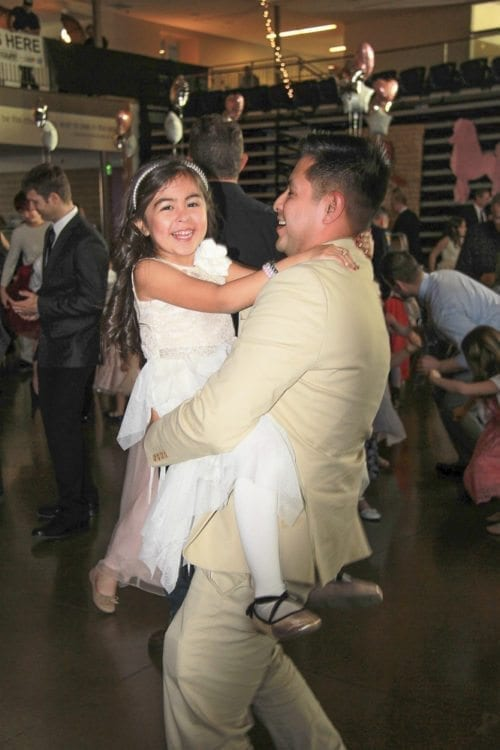 This father and daughter couldn't hold back the smiles Saturday while enjoying the 14th annual Woodland Father/Daughter Ball at Woodland High School. Photo courtesy of Grace Community Church