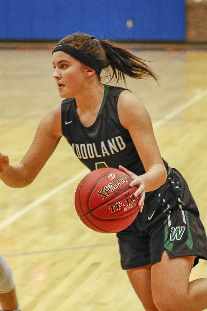 Kaija Olson (4) scored seven of her eight points in the 21-3 run that gave Woodland a victory over Columbia River in the Class 2A District 4 girls basketball tournament Wednesday. The Beavers advanced to the third-place game. Photo by Mike Schultz