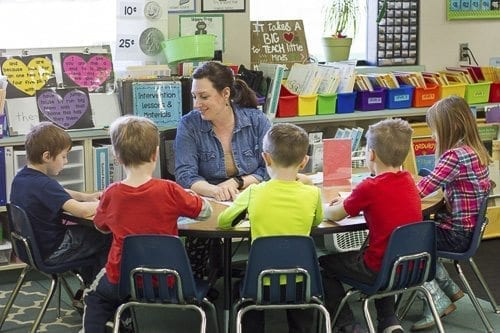 The independence of Play-Based Learning gives teachers like Heather Cacak (pictured here) the time to have group work or help students struggling with a lesson with one-on-one teaching. Photo courtesy of Woodland School District