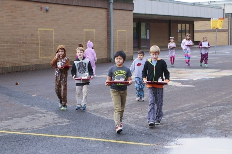 Students at Pleasant Valley Primary must carry their lunches from the main building to their portable classrooms, due to a lack of a cafeteria. Photo courtesy of Battle Ground School District