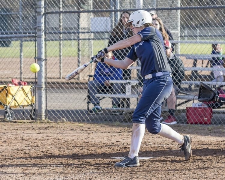 Skyview senior Abby Fischer is known to smash the ball, but she also is a standout behind the plate. An Oregon State signee, Fischer said she takes more pride in being a catcher than a hitter just because of how much work she put into playing the position. Photo by Mike Schultz