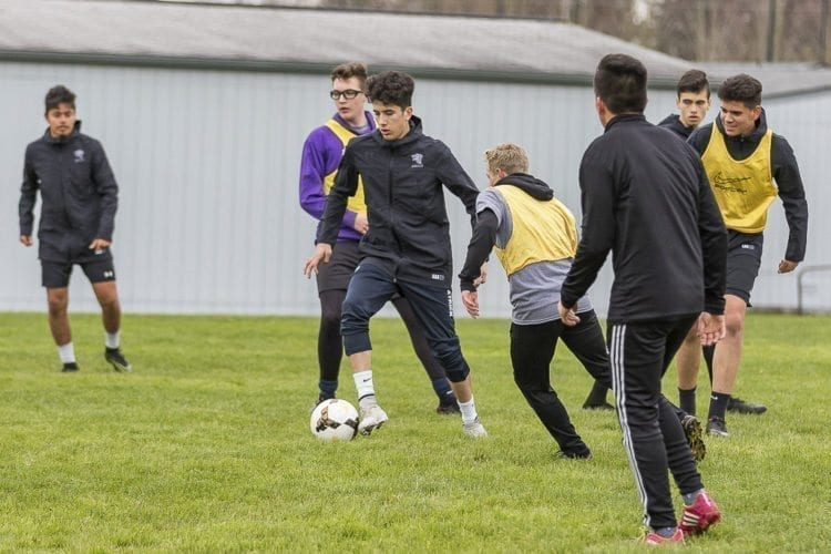 Heritage senior Julian Bojorquez, center, maneuvers between two teammates at practice. Bojorquez recently earned an individual honor by the WIAA but he said he is sharing it with his teammates. Photo by Mike Schultz