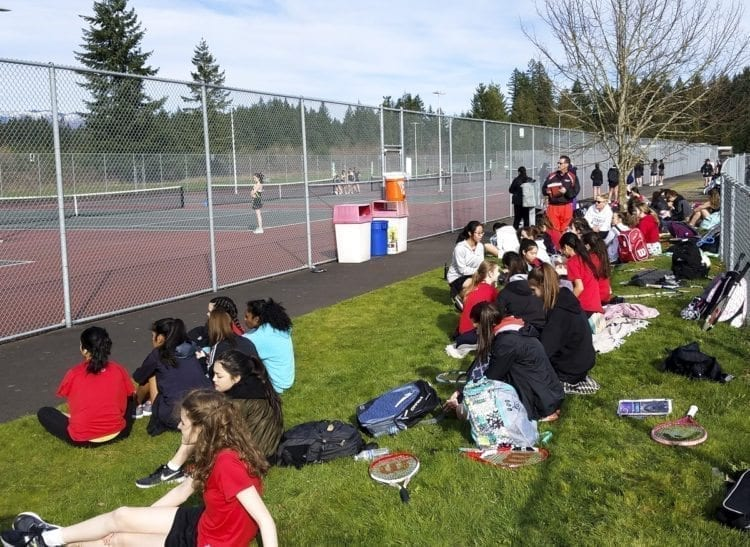 There are tennis eight courts at Camas High School. All are in use, while other players wait their turn. Camas has more than 80 players in its girls tennis program. Photo by Paul Valencia