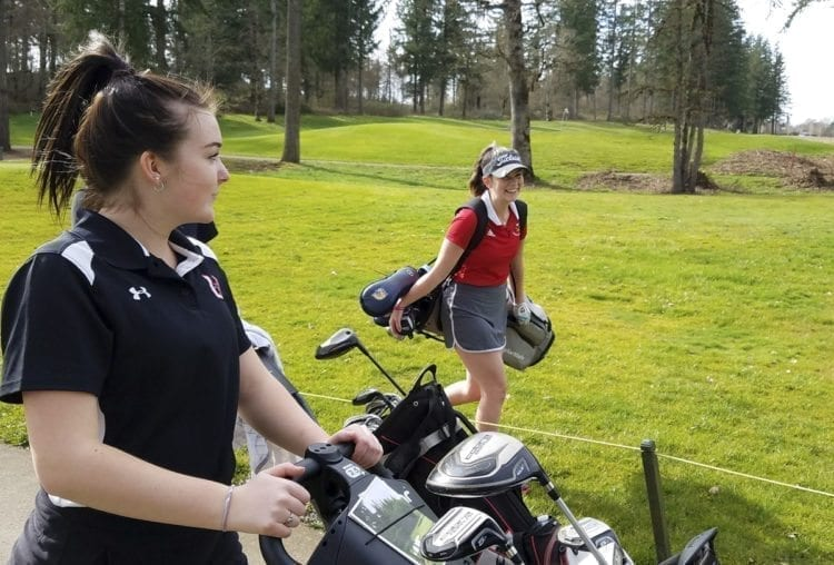 Union golfer Katie Brockley (left) and Prairie's Delainey Patterson are happy to be starting another season of girls golf. Monday featured a lot of wind, but it was a mostly sunny day. Photo by Paul Valencia