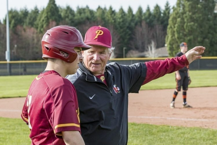 Hall of fame baseball coach Don Freeman is back coaching the Prairie Falcons. Here he is giving a word of advice to one of his players, Trey Herbert, Monday in a game against Battle Ground. Photo by Mike Schultz