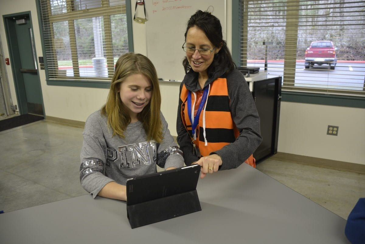 Michele Mederos works with Washougal 8th grade student Simone Velansky on her future plans. Photo courtesy of Washougal School District