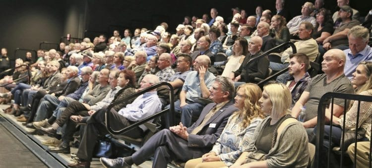 The crowd gathered at Thursday's State of the City Address in Ridgefield listens to new Mayor Don Stose while outgoing Mayor Ron Onslow sits with his wife and family in the audience. Photo courtesy of Rick Browne