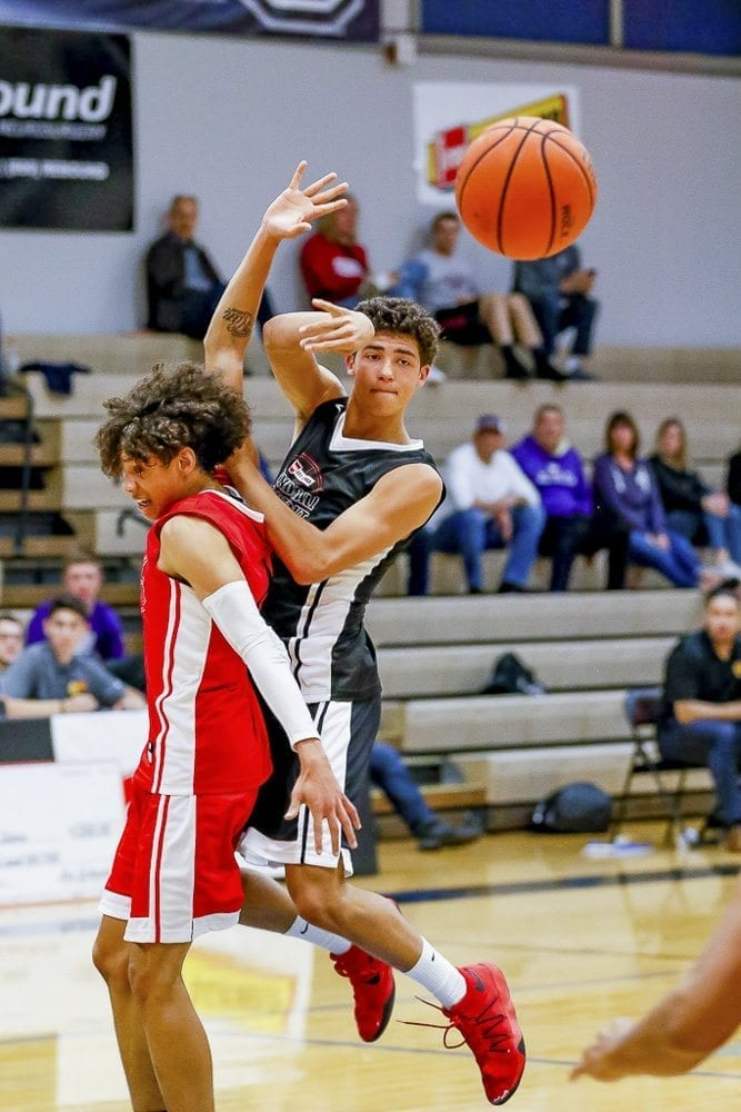 Tre Carlisle (in black) of Camas scored 20 points and was named the Star of Stars for the boys game at the Roundball Shootout. Photo by Mike Schultz