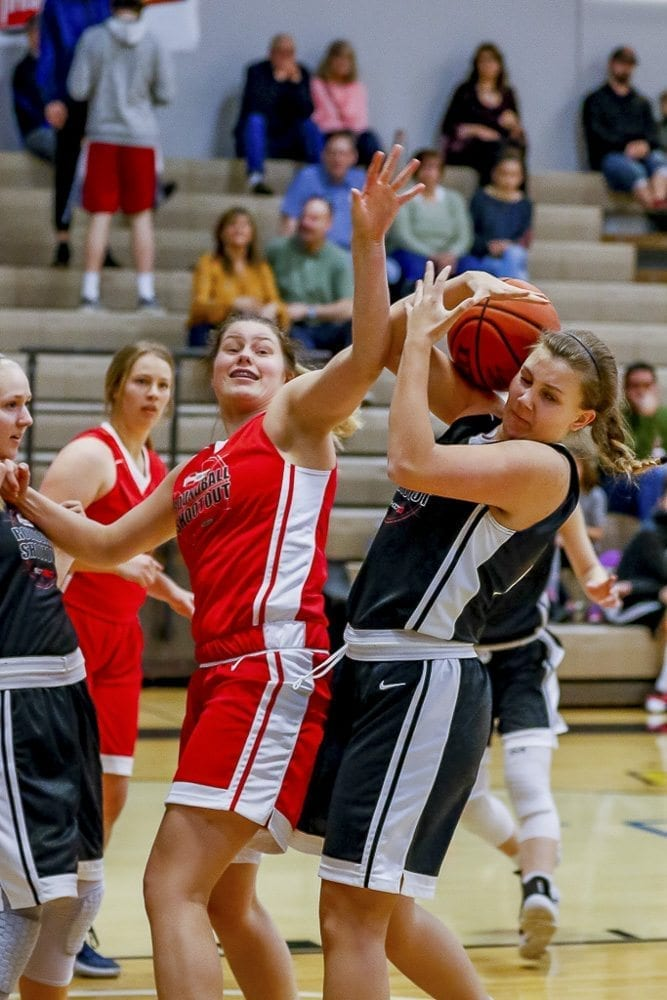 It's Courtney vs. Courtney. Courtney Clemmer of Camas (left, in red) battles Courtney Cranston of Union (in black) at the Les Schwab Tires Roundball Shootout. Photo by Mike Schultz