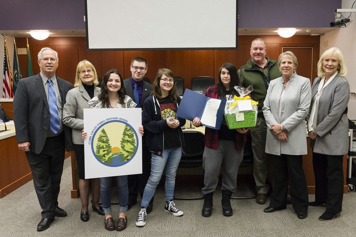 The attached photo was taken by Troy Wayrynen during Tuesday's Clark County Council meeting, during which students from Wayrynen's digital arts class at Heritage High School were honored for their winning entry in a logo contest for the Parks Advisory Board. Pictured (from left to right) are Council Chair Marc Boldt, Councilor Jeanne Stewart, first-place winner Heidi Hayden, second-place winner Eli Entwistle, third-place co-winner Jennifer Jones, third-place co-winner Viktoria Kryshtal, Parks Manager Bill Bjerke, Councilor Julie Olson and Councilor Eileen Quiring. Photo courtesy of Clark Co. WA Communications
