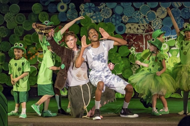 The Bullfrog, played by Benedict Alexander (left) helps to cheer up The Ugly Duckling, played by Trenton Harris (right), with a musical number. CYT plays are open to children ages 4 to 18, and offer not only instruction on theater production but also character development. Photo by Mike Schultz