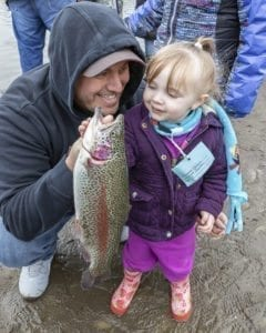 Jason and Mai'ana Candaso, of Vancouver, pose with the young girl's catch at the Klineline Kids Fishing Derby Saturday morning. Photo by Mike Schultz