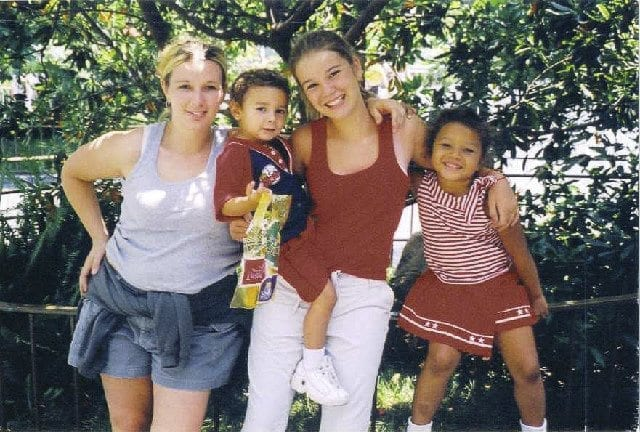 Michelle Singleton is seen with three of her children while pregnant with her youngest in 2003. Photo courtesy of Michelle's Love