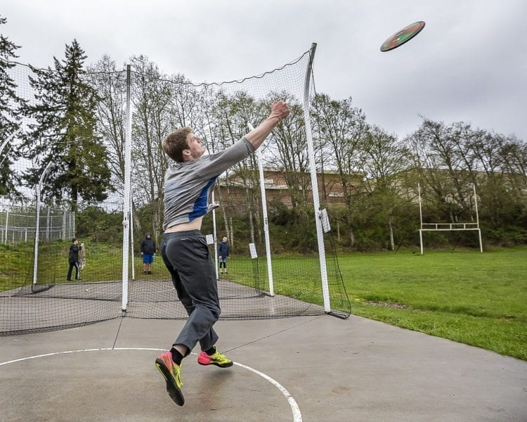 The sky is the limit for Trey Knight's athletic abilities. A sophomore from Ridgefield, he hopes to one day represent America in the Olympics in the hammer throw, but he also excels in the discus (shown here) and shot put. Photo by Mike Schultz