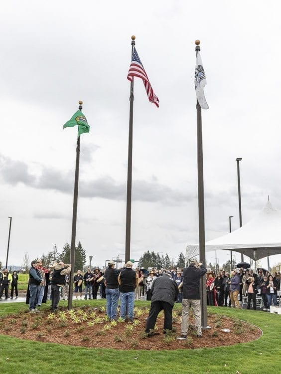 The Cowlitz Tribal flag is raised for the first time in 160 years on tribal land. Photo by Mike Schultz