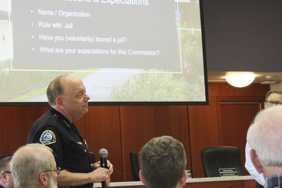 Battle Ground Police Chief Bob Richardson prepares to speak during the first gathering of the Clark County Corrections Facility Advisory Commission Tuesday night in Vancouver. Photo by Eric Schwartz