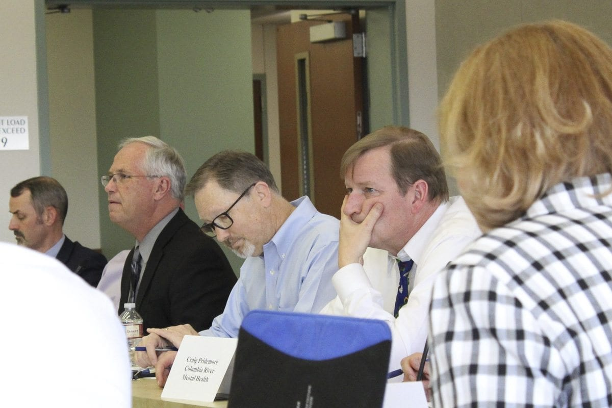 From left, Vancouver City Manager Eric Holmes, Clark County Council Chairman Marc Boldt, facilitator Erik Jensen, commission chairman Craig Pridemore and Vancouver Mayor Anne McEnerny-Ogle listen to discussion during the first meeting of the Clark County Corrections Facility Advisory Commission Tuesday in Vancouver. Photo by Eric Schwartz