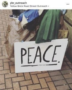 This sign sits against one homeless person's possessions in downtown Vancouver. Photo courtesy Janus Youth Services
