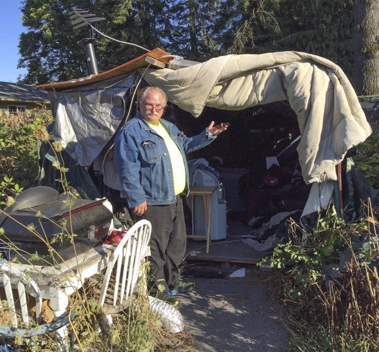 """Jackson"" shows off his home in Clark County. Photo courtesy Council for the Homeless"
