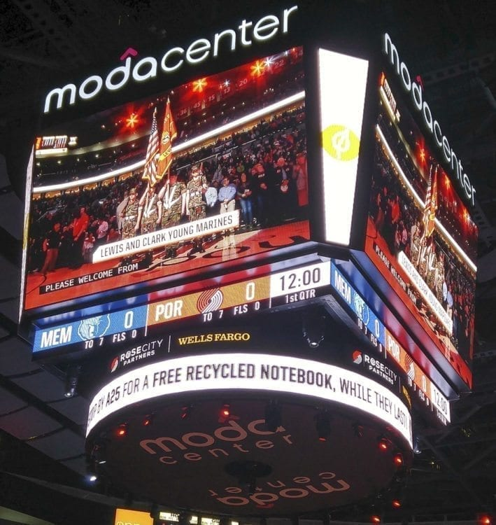The Lewis & Clark Young Marines are pictured on the jumbotron at the Moda Center in Portland April 1. This photo was taken just hours before the group's Suburban caught fire en route back to Clark County. Photo courtesy of Debbie Crawford
