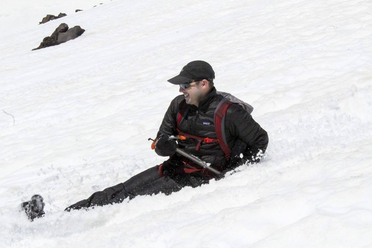 A man smiles while glissading down Mount St. Helens Tuesday. Photo by Eric Schwartz